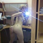 Naked girl takes a selfie in the office