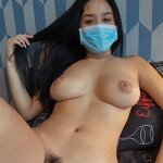 COVID-19: Naked girl in a medical mask
