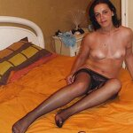 MILF in stockings on the bed, pic 13