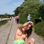 Naked girl by the city beach, pic 28