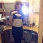 Naked girl takes a selfie in the office, pic 4