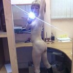 Naked girl takes a selfie in the office, pic 7