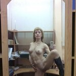 Naked girl takes a selfie in the office, pic 12