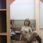 Naked girl takes a selfie in the office, pic 13