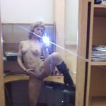 Naked girl takes a selfie in the office, pic 14
