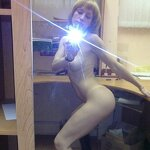 Naked girl takes a selfie in the office, pic 15