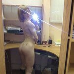 Naked girl takes a selfie in the office, pic 18