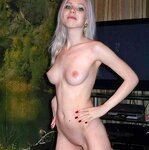 Slim blonde nude in the living room, pic 11