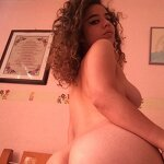 Curly haired beauty posing naked, pic 13
