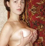 Unshaven pussy posing in a carpet, pic 3