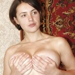 Unshaven pussy posing in a carpet, pic 11