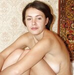 Unshaven pussy posing in a carpet, pic 24