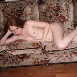 Redhead masturbates on the couch, pic 3
