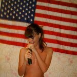Whore posing naked under the flag of her country, pic 10
