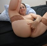 Wife in stockings on a black bedspread, pic 18