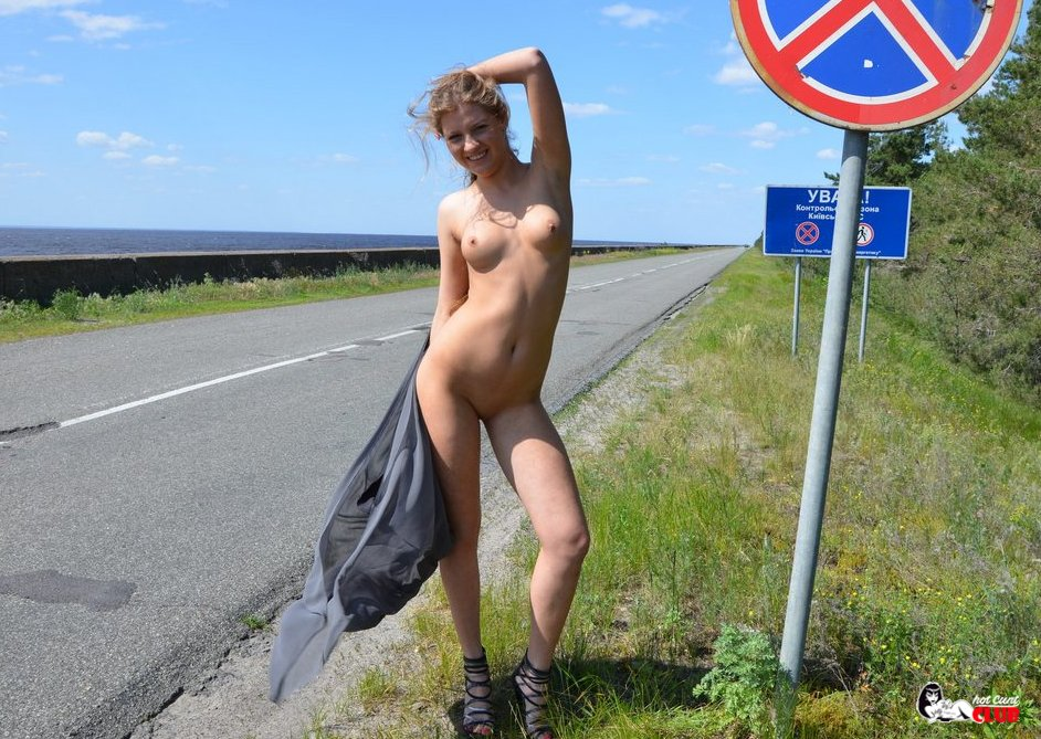 Naked woman causes a scene in traffic, during road rage altercation